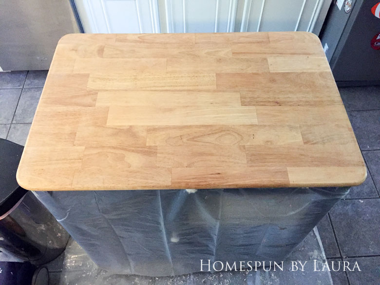 Stripping the faux painted marble finish down to original butcher block on my navy kitchen island   Homespun by Laura