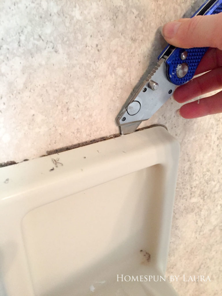How to replace old caulk for a dramatic impact in a bathroom.   Homespun by Laura