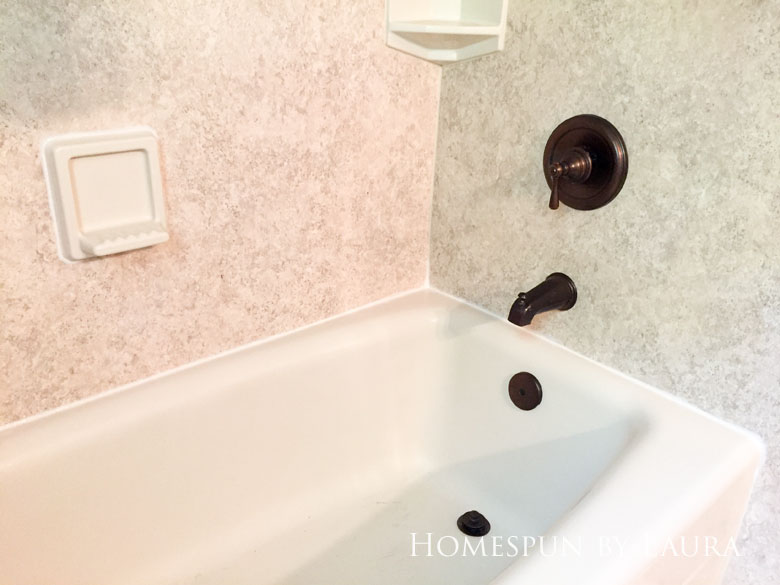 Replacing old caulk makes a dramatic impact in a bathroom.   Homespun by Laura