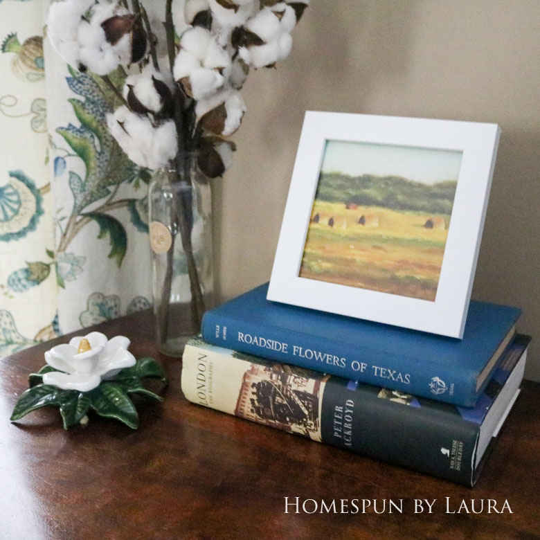 Cleaned up antique brass hardware, cotton stems, and hardback books dress up a boring desk in the den   Homespun by Laura